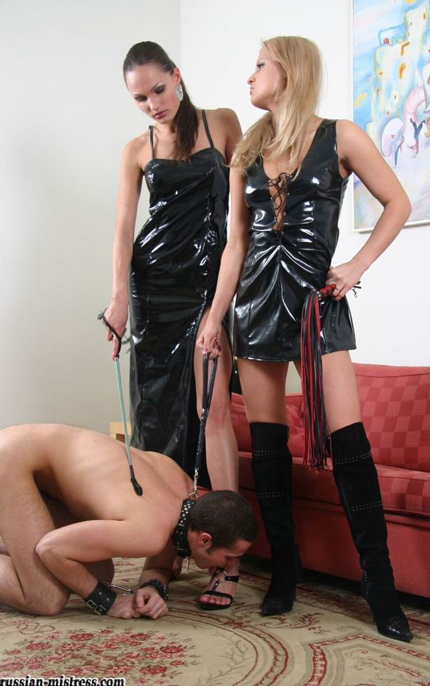 Two masterful latex ladies torturing their leashed slave